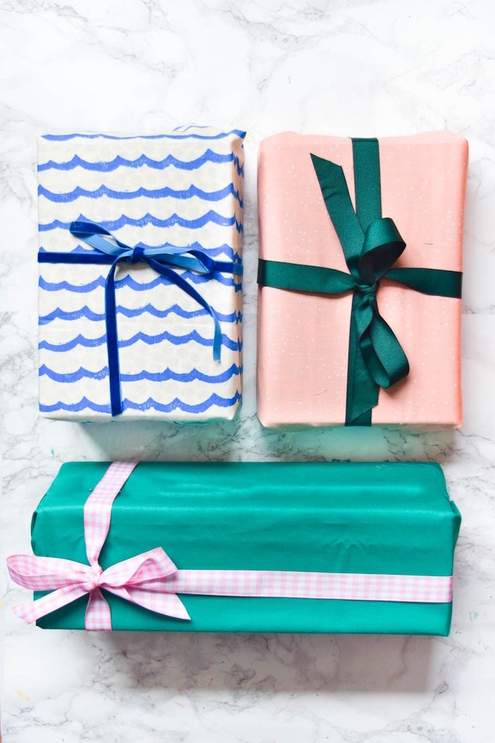 three presents wrapped in fabric in turquoise blue white pink how to wrap a present wrapped with bows in pink green blue