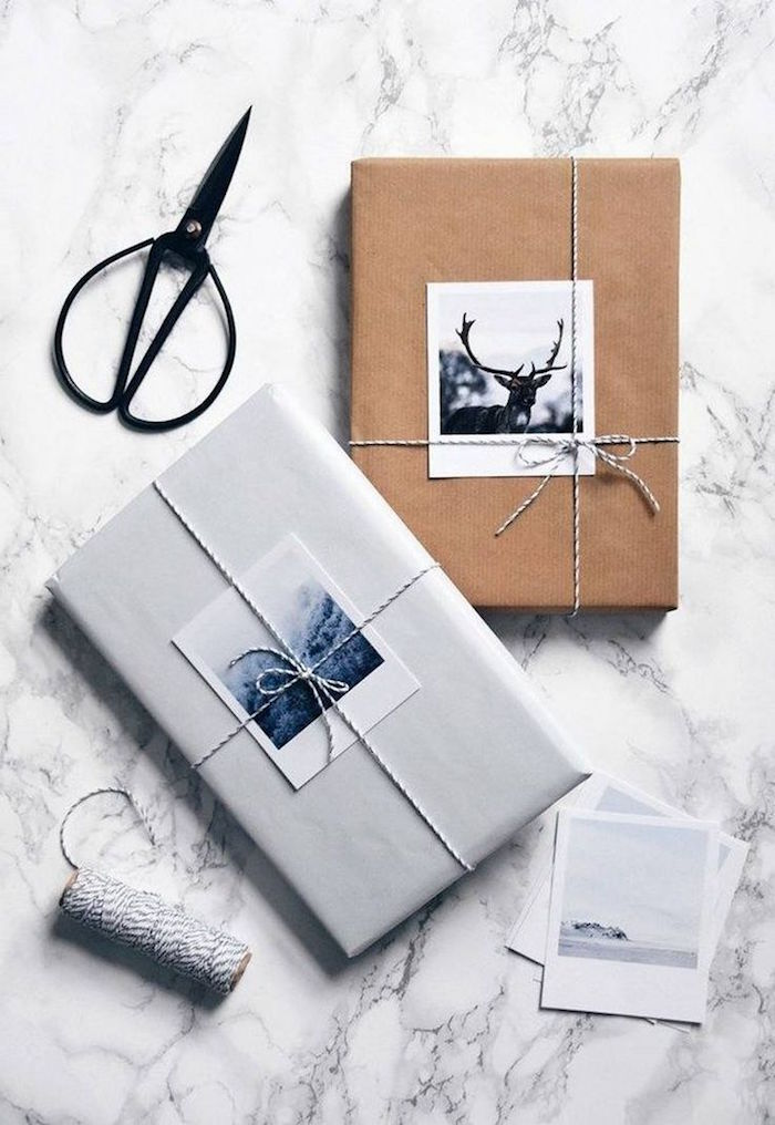 two boxes wrapped with white and brown paper gift packing ideas two photos tied with small ribbons