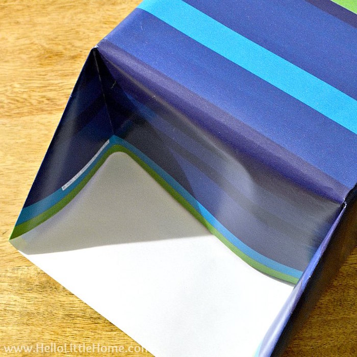 wrapping a present with wrapping paper in different shades of blue and green christmas gift wrapping ideas diy tutorial