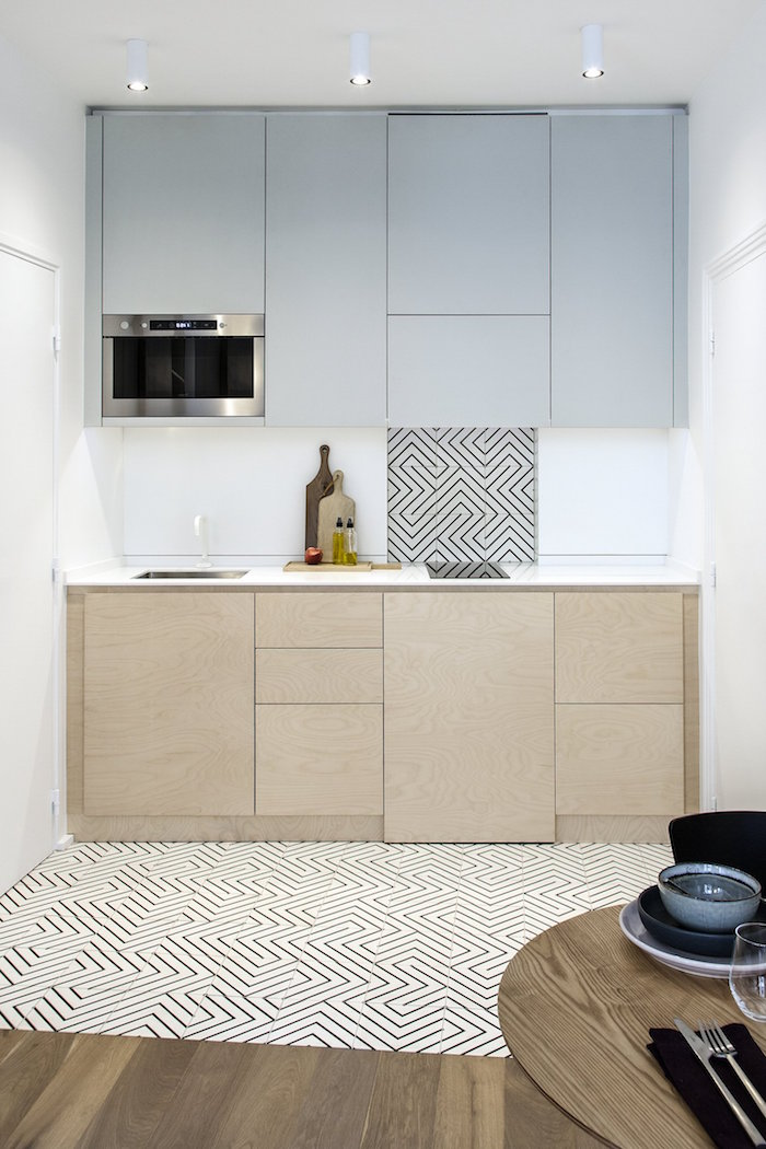 black and white tiles on the floor matching part of the backsplash small kitchen design ideas light gray and wooden cabinets