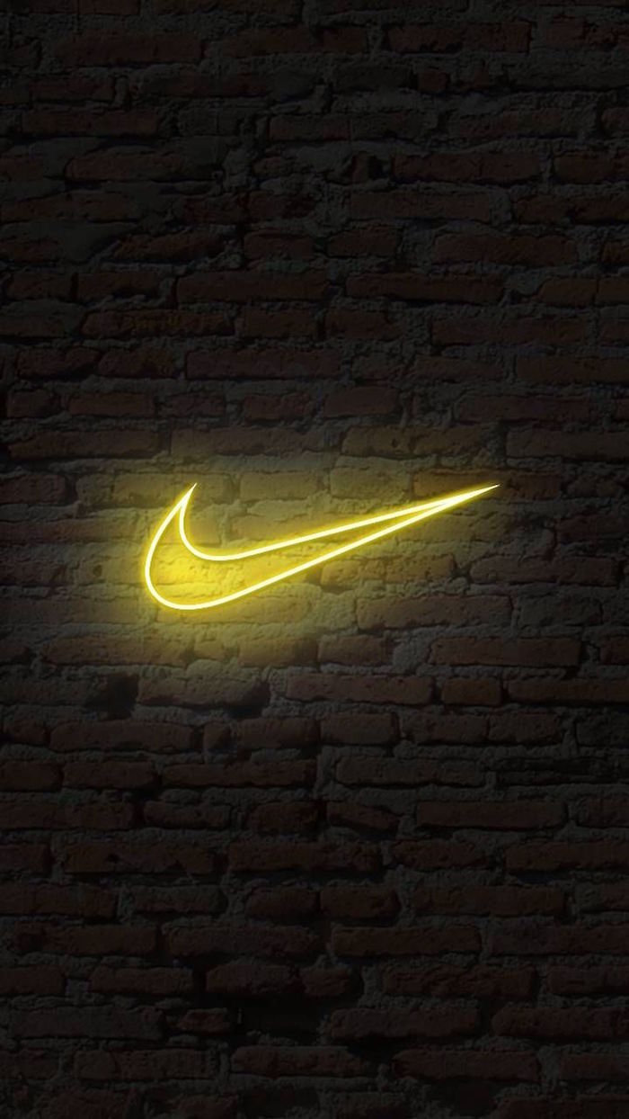black background with brick wall just do it wallpaper yellow nike neon logo in the middle