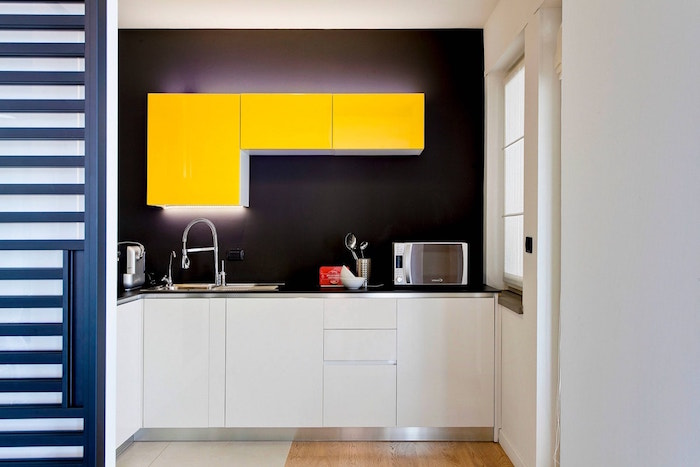 black backsplash yellow kitchen cabinets with led lights small kitchen remodel ideas wooden floor