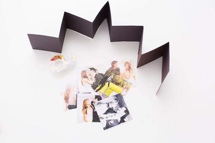 black cardstock glued together folded what to get your boyfriend for valentines day photos spread out on white surface