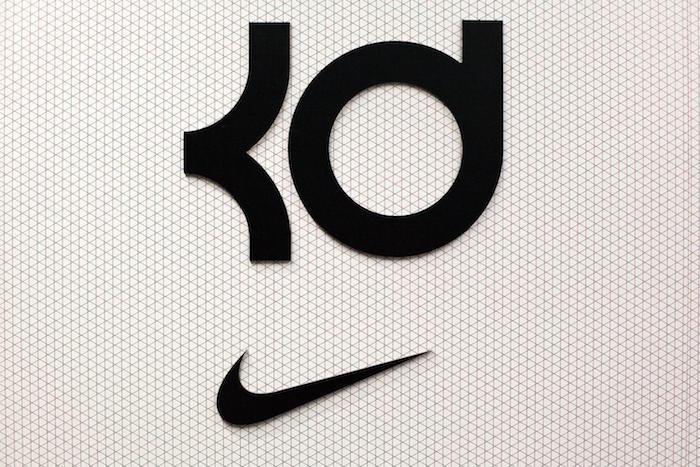 black kd logo over a black nike logo nike background white and black geometric background kevin durant