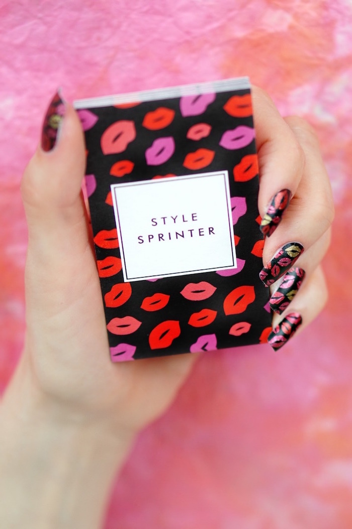 black nail polish on long coffin nails valentine's day acrylic nails red gold pink glitter lips drawn on each nail