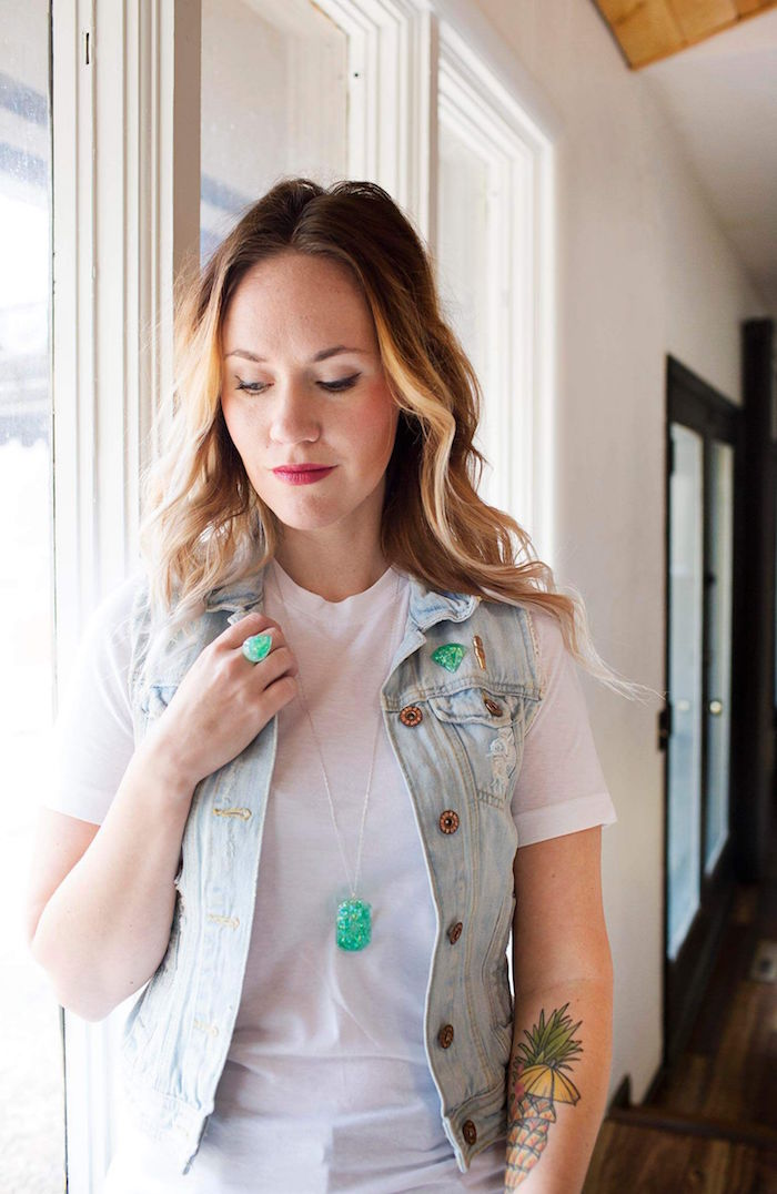 blonde woman wearing white shirt denim vest resin jewelry kit ring necklace and pin made of turquoise resin
