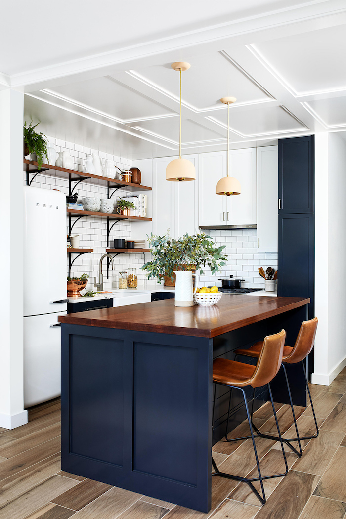 blue accents wooden countertop on kitchen island with bar stools small kitchen design ideas open shelving on white subway tiles backsplash