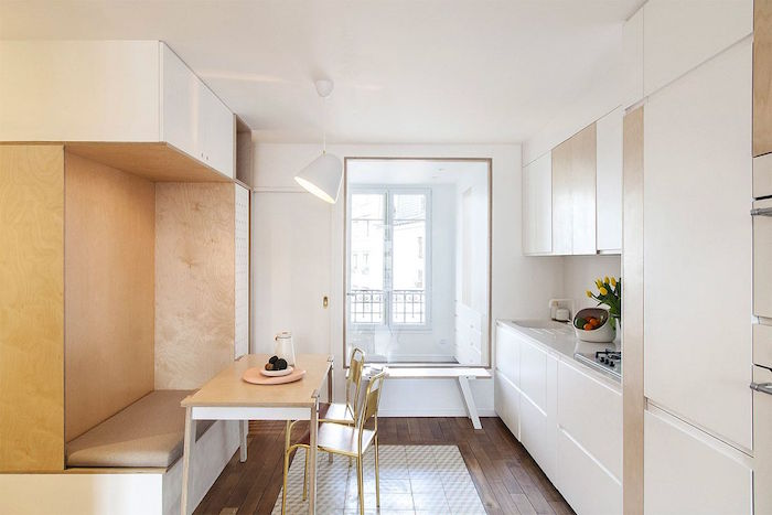 breakfast nook with wooden table and chairs small kitchen remodel white kitchen cabinets and countertop wooden floor