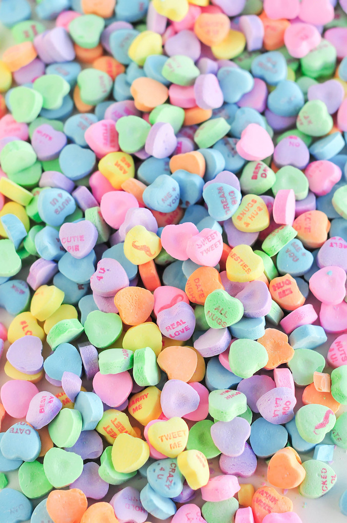 candy conversation hearts in different colors with different sayings valentines day wallpaper close up photo