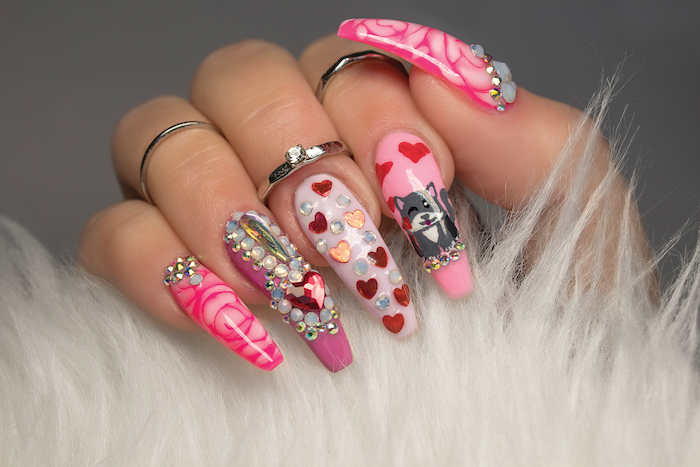 cat hearts roses drawn on long coffin nails with pink nail polish valentines day nails 2021 lots of decorations with rhinestones