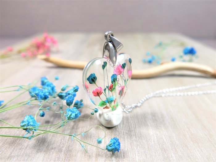 clear necklace pendant in the shape of a heart with dried flowers inside in pink blue green resin earrings