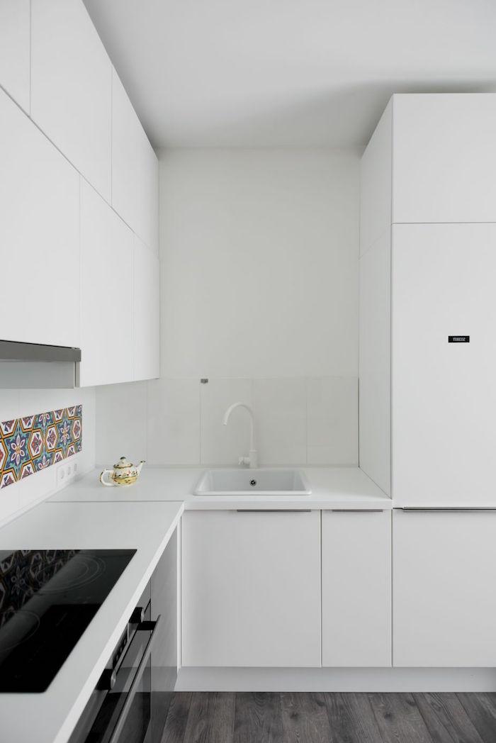colorful tiles on white backsplash small kitchen design ideas white kitchen cabinets white countertops dark wooden floor