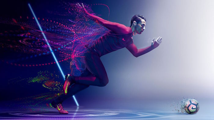 cristiano ronaldo running after football nike wallpaper dressed in nike gear purple and white background