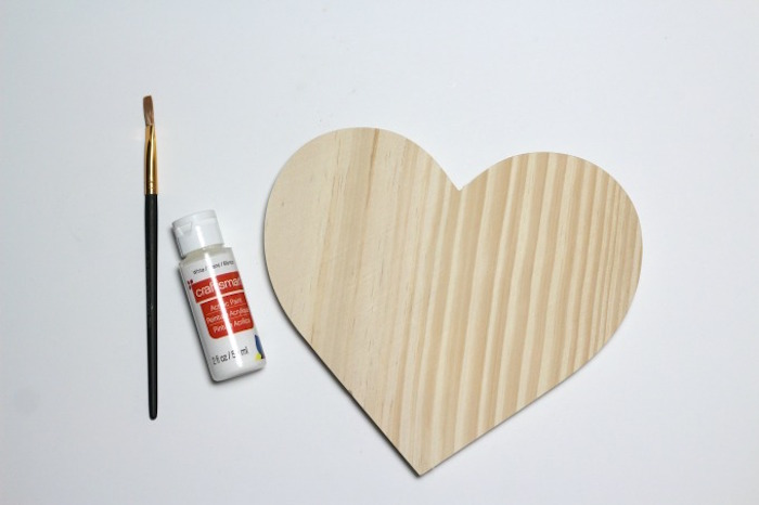cute things to get your boyfriend for valentines day wooden heart with glue and paintbrush placed on white surface