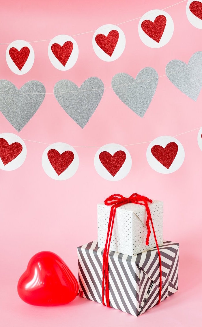 cute valentines day wallpaper pink background red and silver hearts garland red heart shaped balloon two presents wrapped in black white wrapping paper
