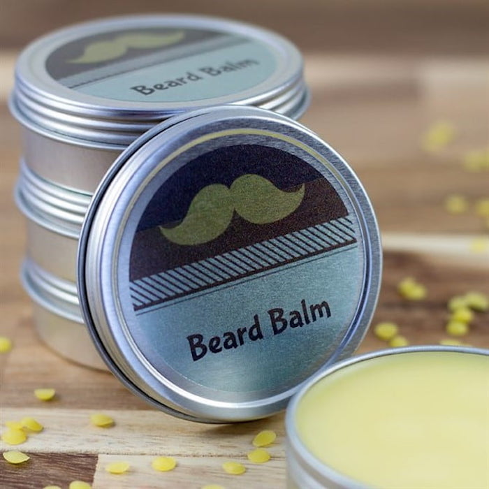 diy beard balm placed inside small tin jars what to get a guy for valentines day placed on wooden surface