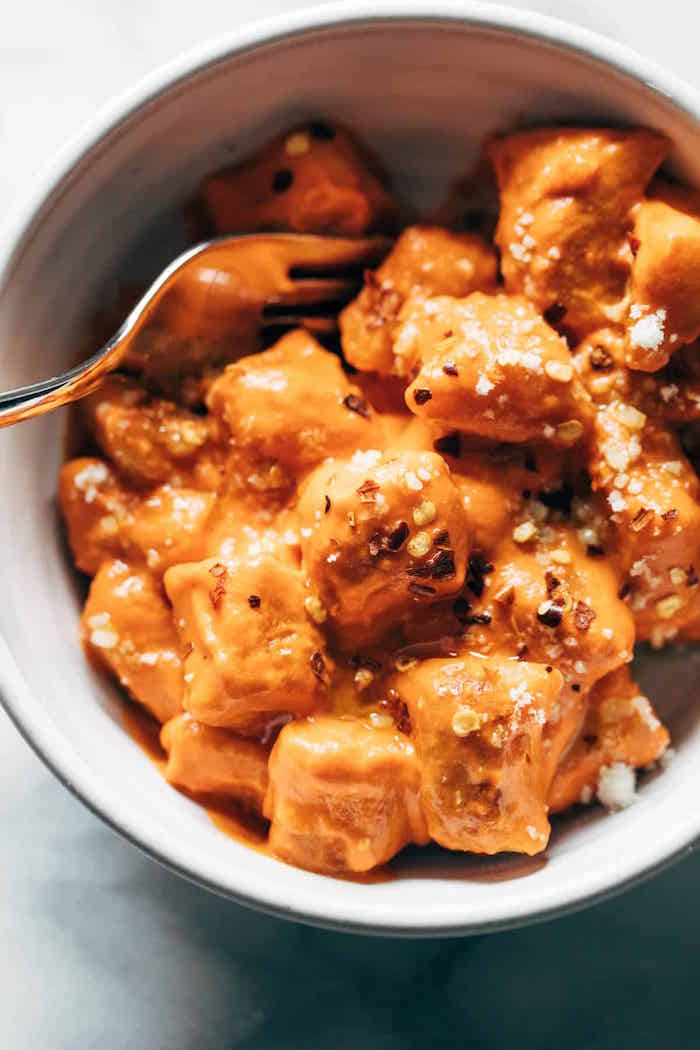 easy gnocchi recipe cooked cauliflower gnocchi with sauce garnished with chilli pepper flakes