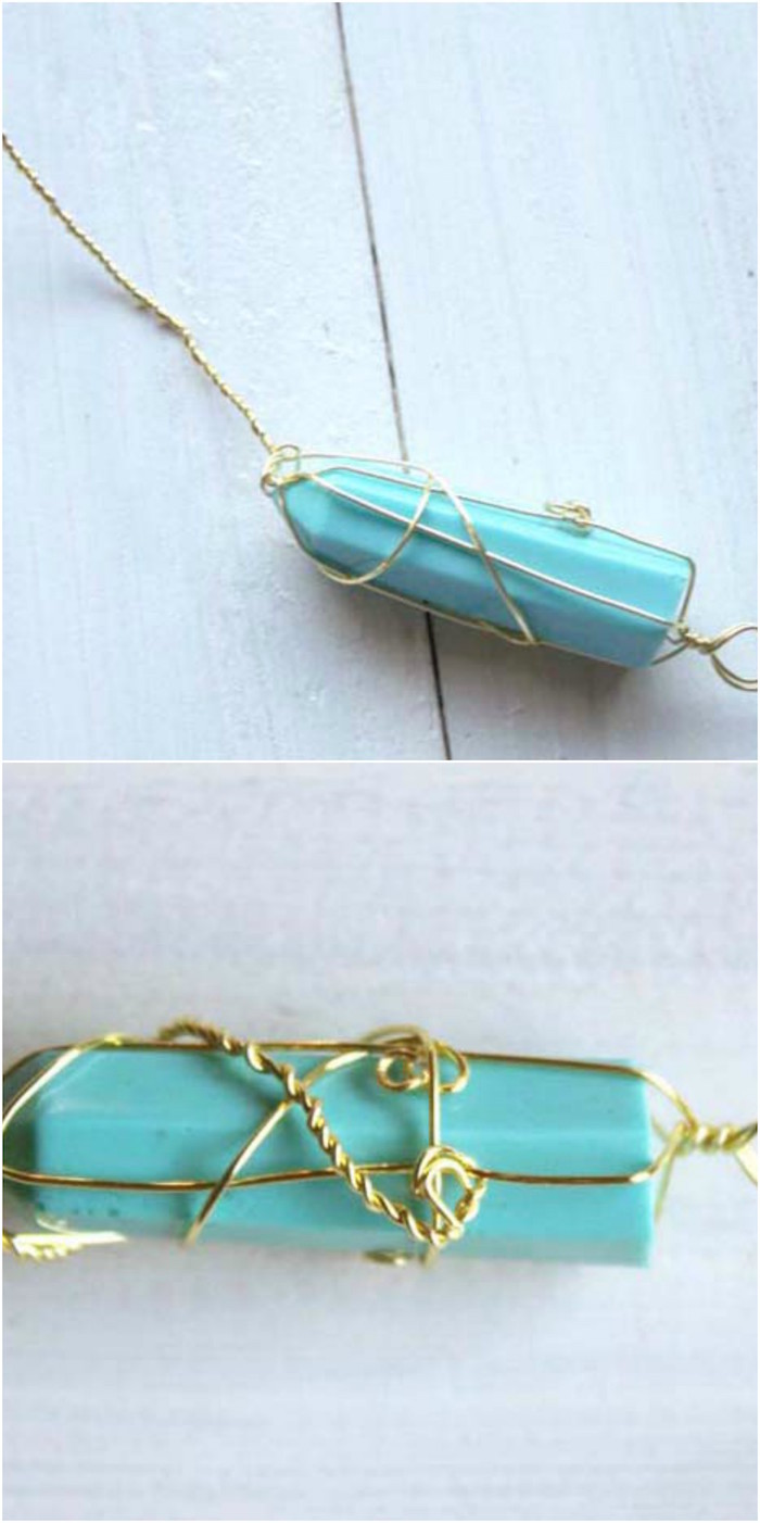 faux crystal pendant necklace wrapped in gold wire step by step diy tutorial placed on white wooden surface resin necklace