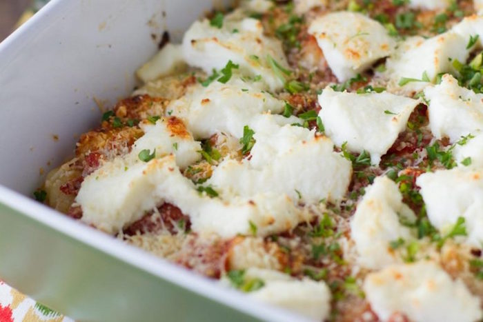 gnocchi baked with ricotta cheese in white casserole dish best gnocchi recipe garnished with chopped parsley