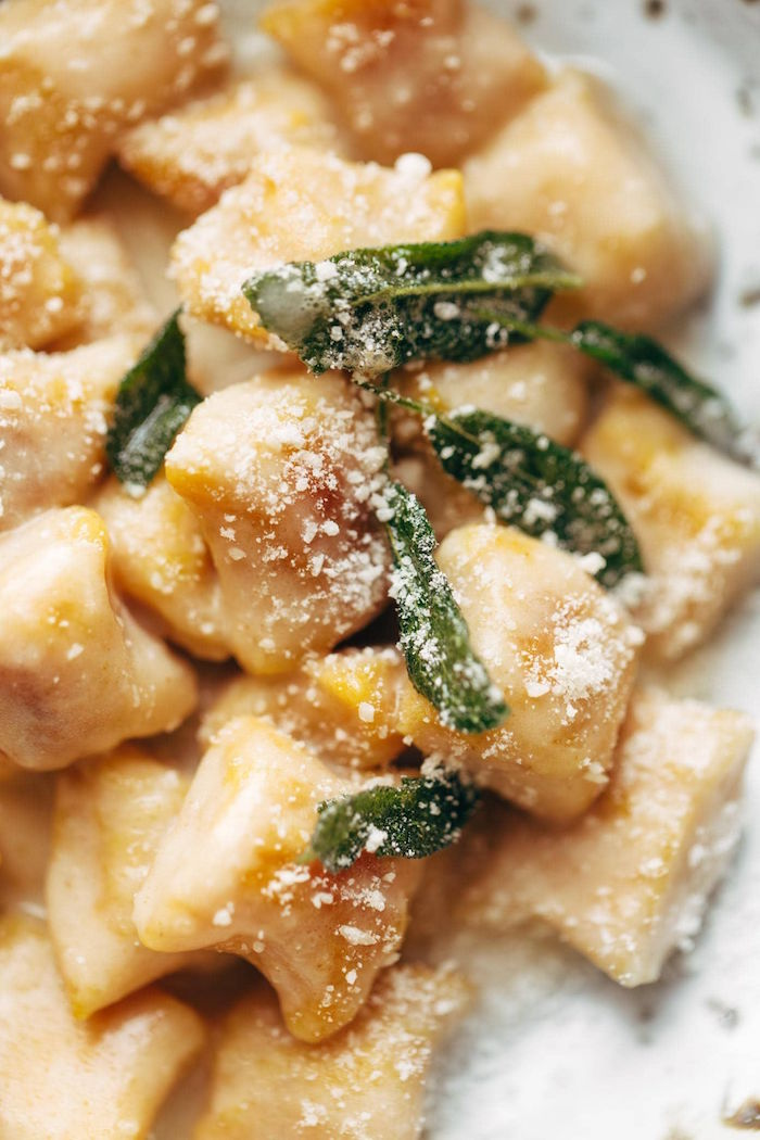 gnocchi made from pumpkin easy gnocchi recipe cooked with cheesy sauce garnished with fresh mint leaves grated parmesan cheese