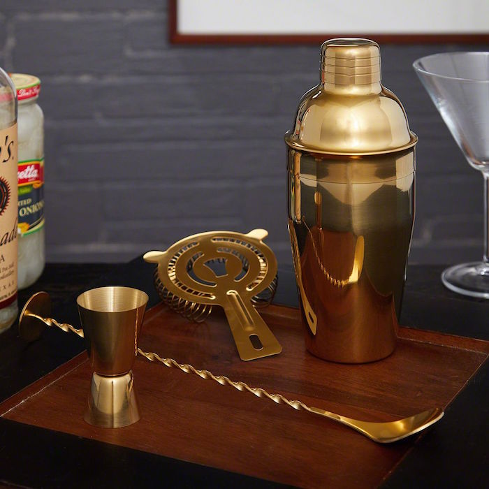 gold bartender kit valentines day gifts for boyfriend shaker spoon measuring cup placed on wooden board