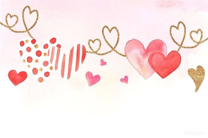 gold red and pink watercolor hearts drawn in different shapes and sizes on white background valentines day background