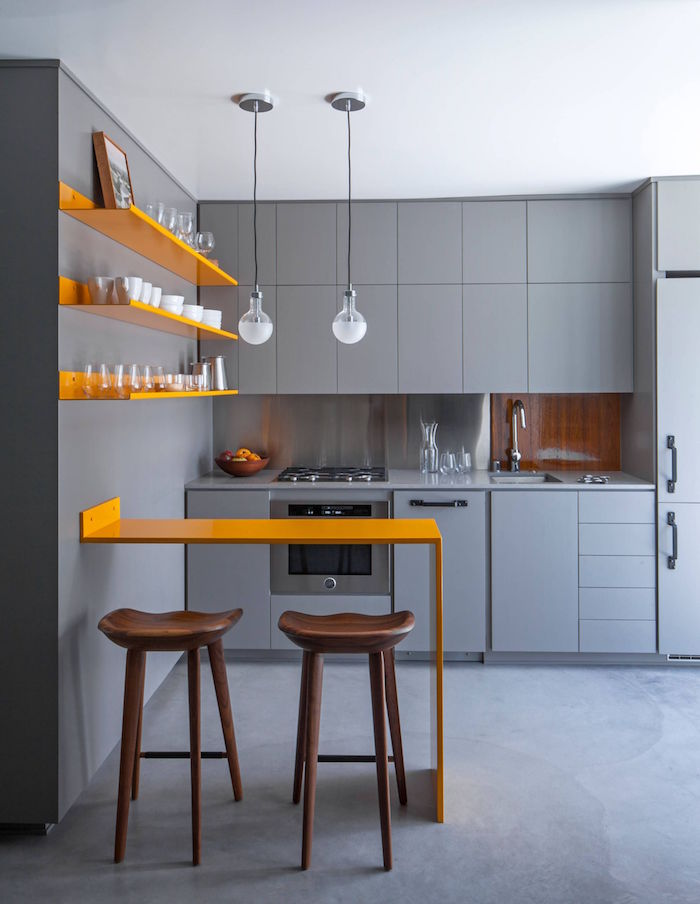 gray kitchen cabinets with orange open shelves on gray wall kitchen layout ideas orange table wooden bar stools