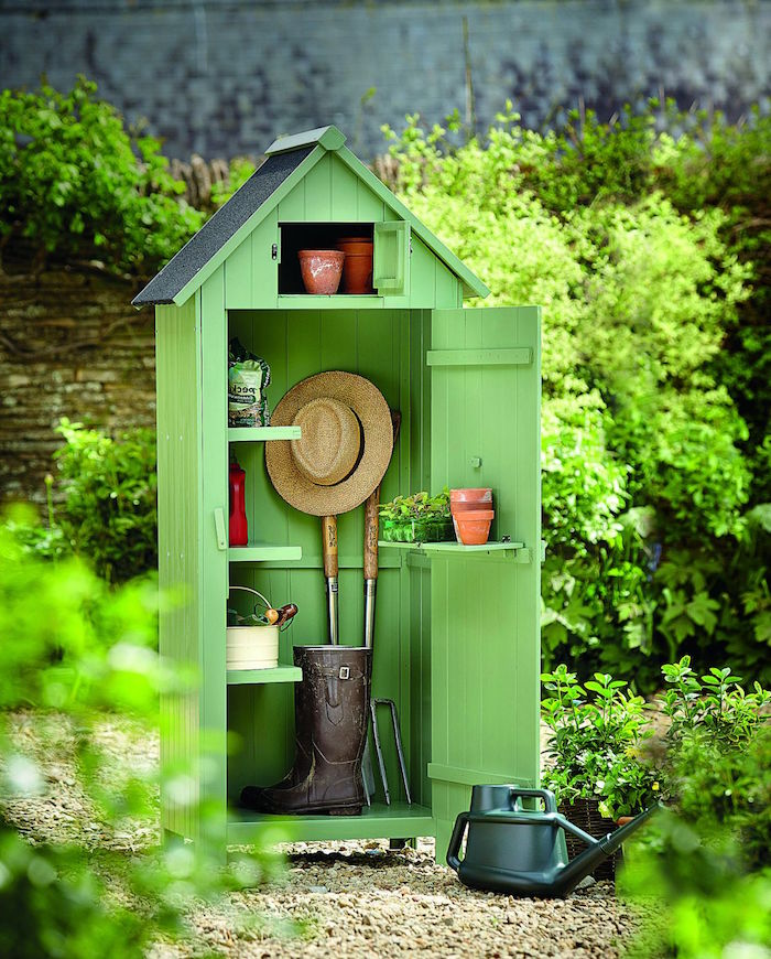 green wooden shed for gardening tools diy storage space small wooden shelves installed inside and on the door