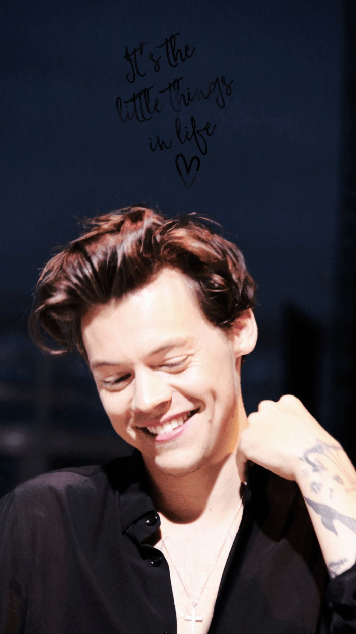 its the little things in life written over photo of harry smiling wearing black shirt aesthetic harry styles