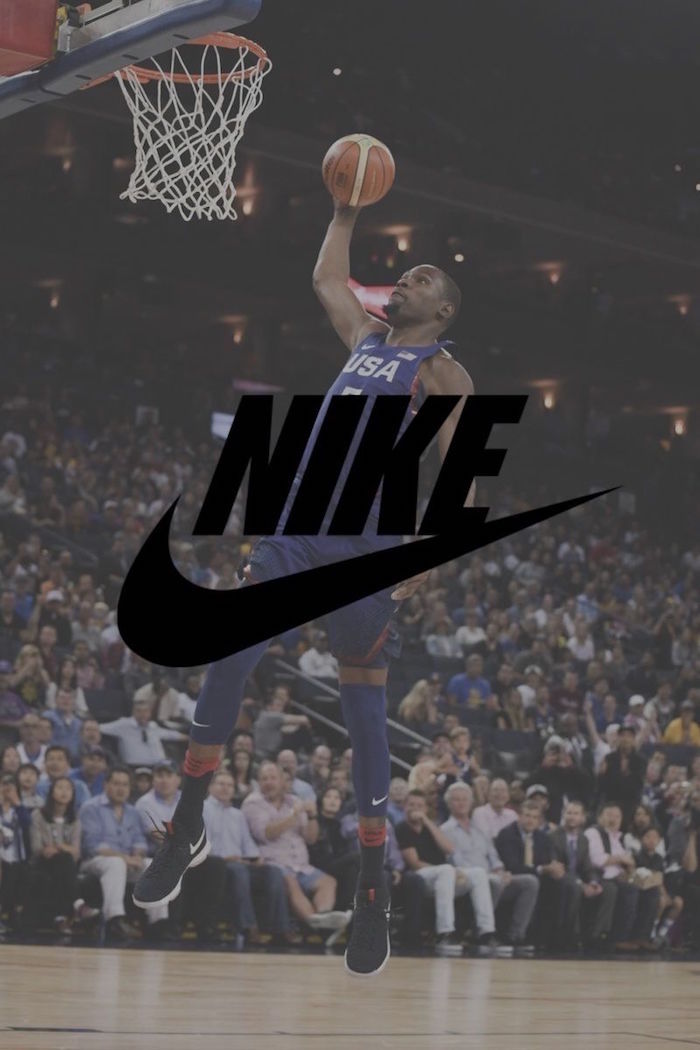 kevin durant wearing usa uniform in blue on the court about to dunk the ball nike logo wallpaper black nike logo in the middle
