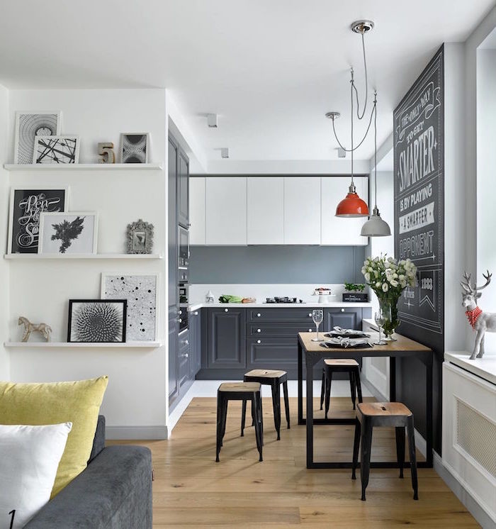 kitchen cabinet ideas gray backsplash white and black cabinets white countertop wooden floor wooden bar stools