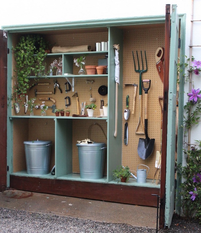 large wooden shed for gardening tools painted in turquoise shelves installed inside diy storage space