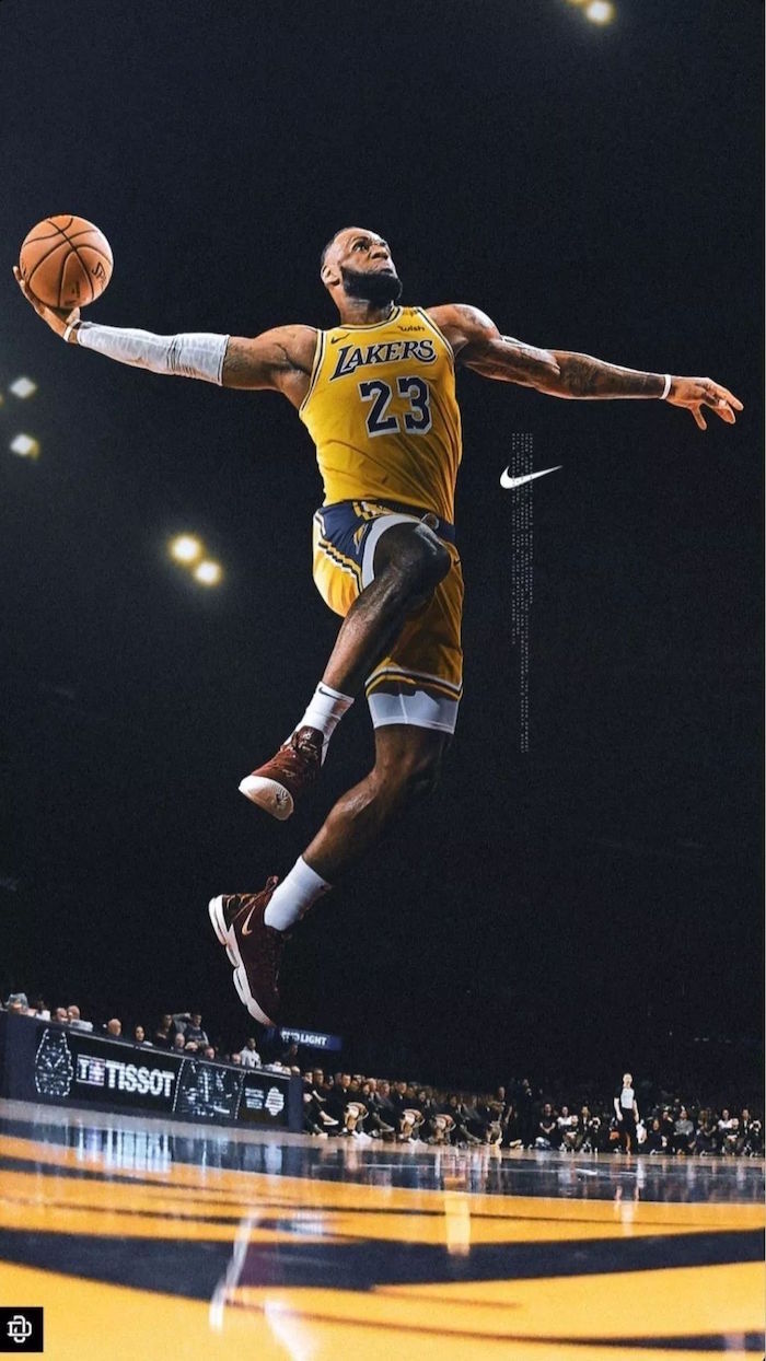 lebron james wearing gold and purple lakers unifrom about to dunk the ball nike logo wallpaper nike logo on the side