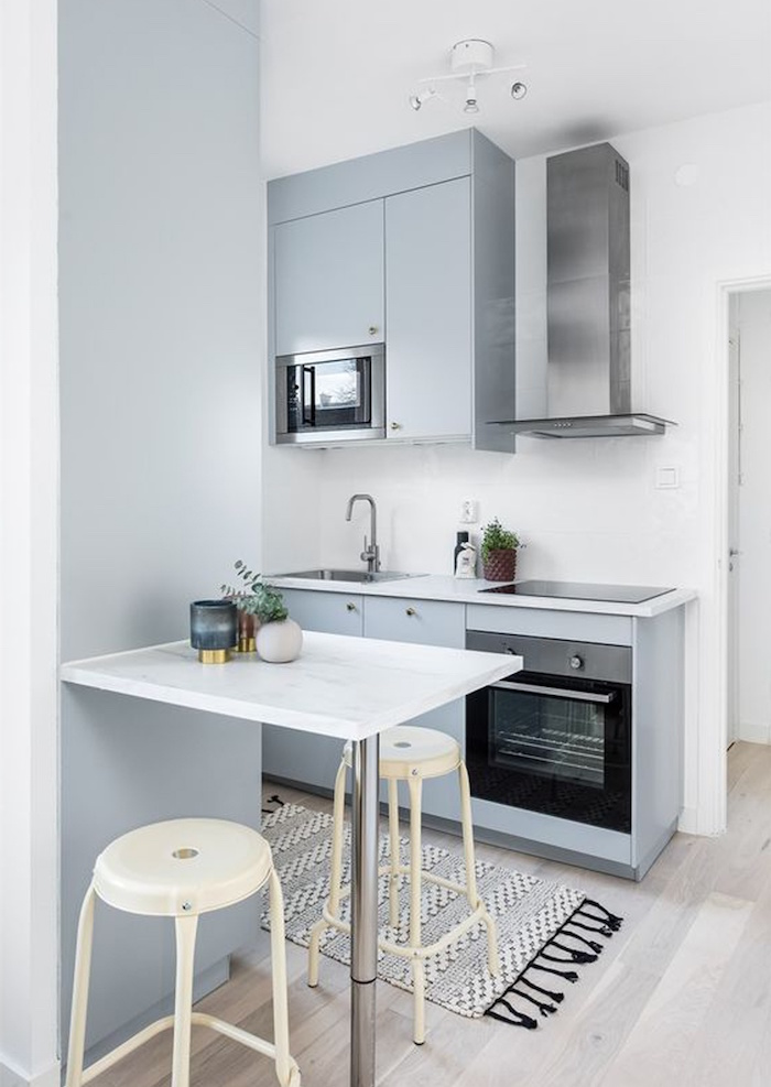 light blue kitchen cabinets white countertops kitchen design ideas mini table with two white bar stools