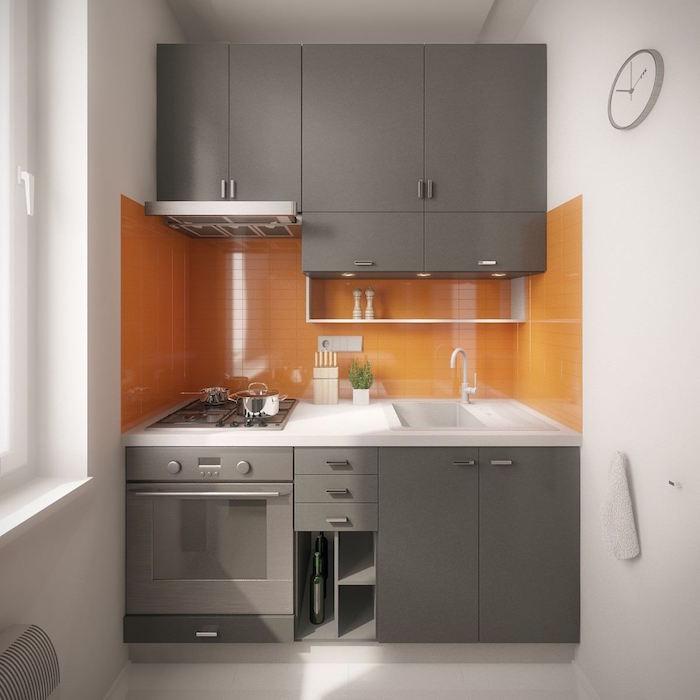 light gray kitchen cabinets orange tiled backsplash small kitchen remodel white walls and floor