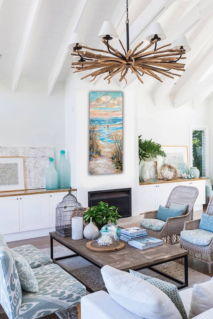 living room with rattan armchairs gray and white sofas with blue throw pillows beach house decor wooden chandelier