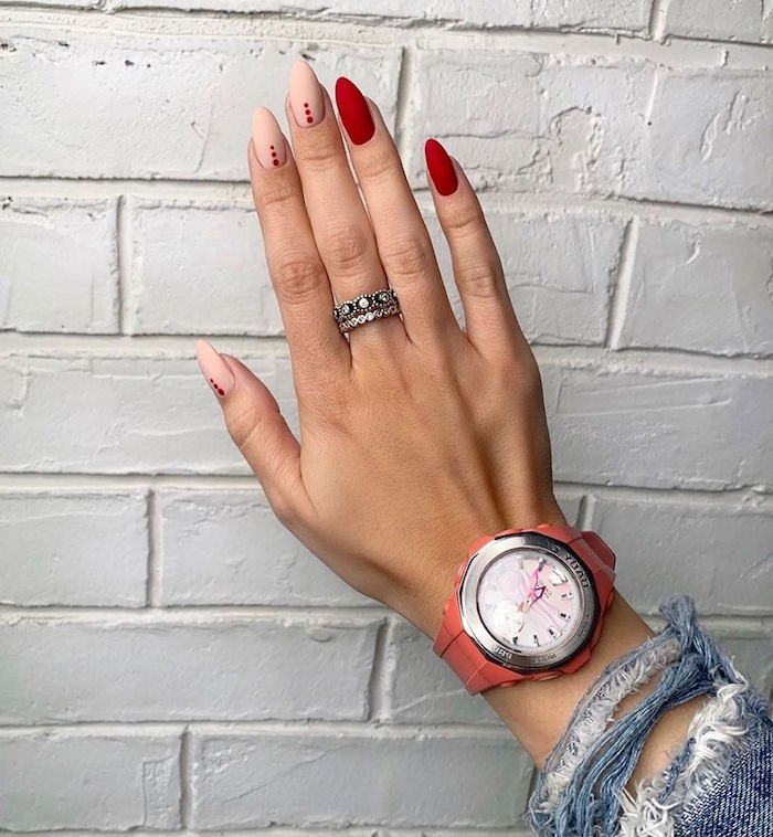 long almond nails covered with red and beige matte nail polish cute nail designs orange watch silver rings