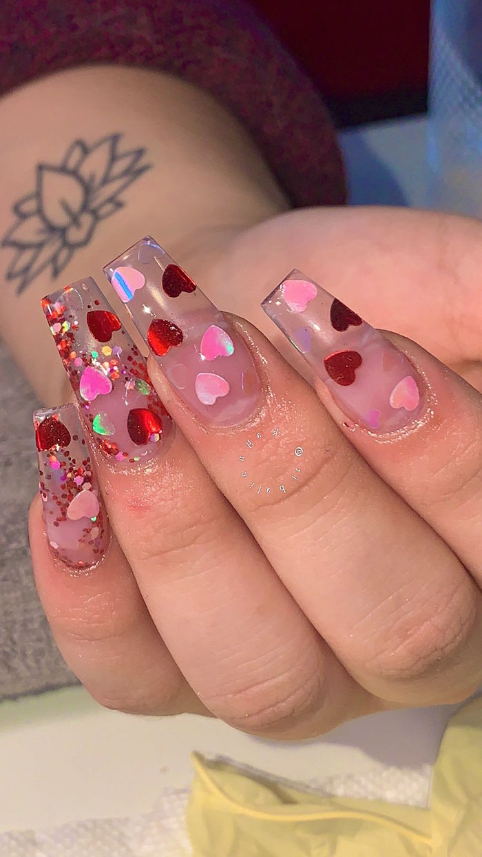 long coffin nails made with acrylic valentines nails red and pink hearts and glitter on them