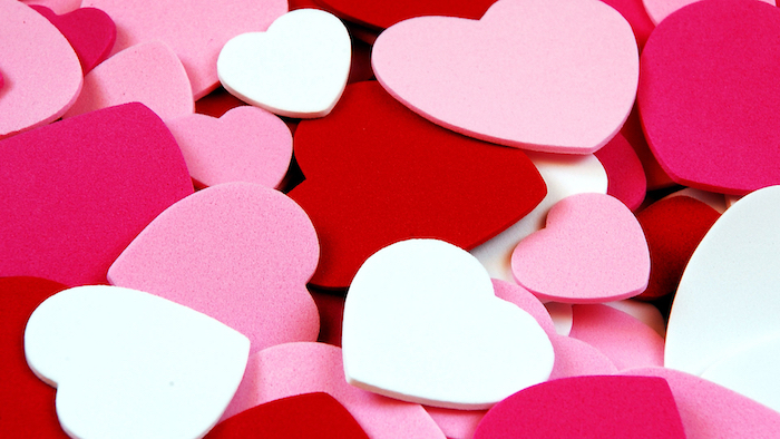 lots of red white and pink hearts in different shades shapes and sizes arranged together valentines background