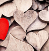 lots of wooden blocks in the shape of hearts arranged together happy valentines day red wooden heart on top