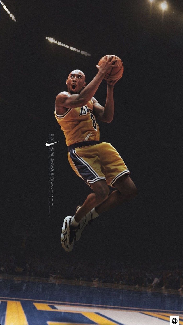 nike shoes wallpaper kobe bryant wearing gold and purple lakers uniform in the air holding the ball nike logo on the side