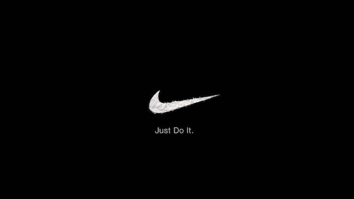 nike wallpaper iphone just do it written in white under white nike logo drawn on black background