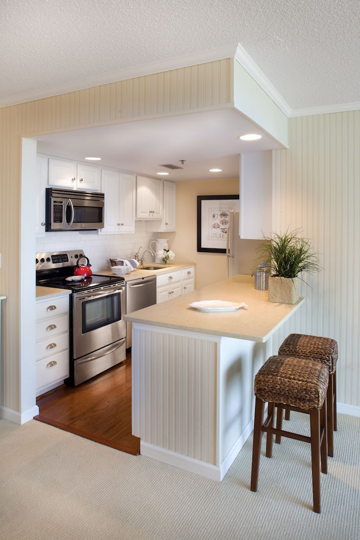 open plan kitchen with white kabinets small kitchen ideas white subway tiles backsplash wooden floor small kitchen island