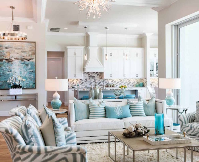 open plan living room and kitchen beach house decor white sofas and armchairs with blue and gray throw pillows
