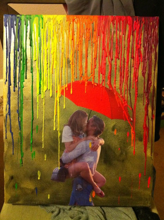 photo of couple kissing umbrella above them on gold background valentine gift for husband crayons melted for rain in the colors of the rainbow