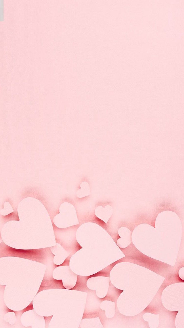 pink background pink hearts in the bottom in different sizes valentine's day 2021 minimalistic wallpaper