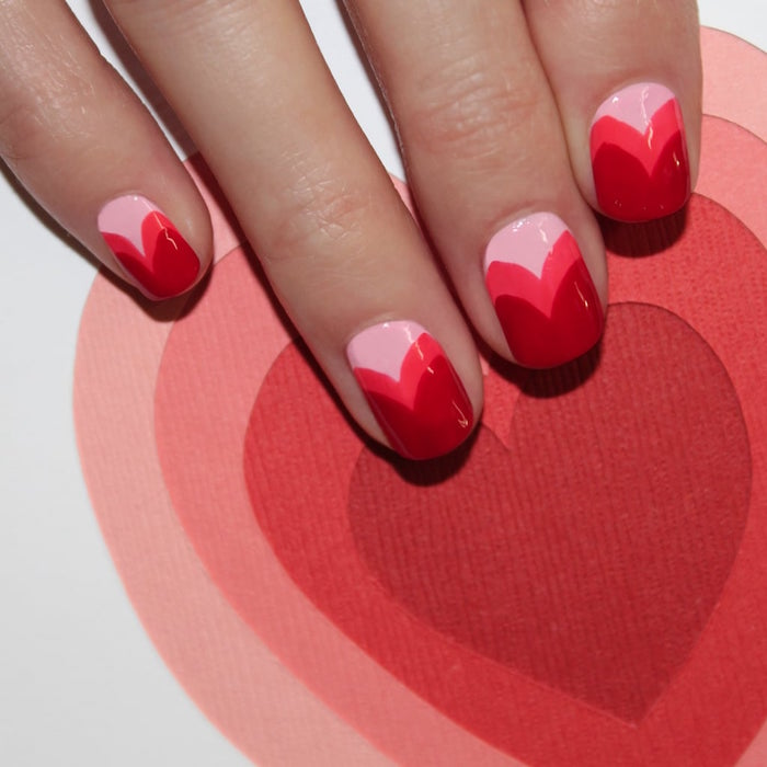 pink red ombre in the shape of hearts on each nail valentines day nail ideas short squoval nails
