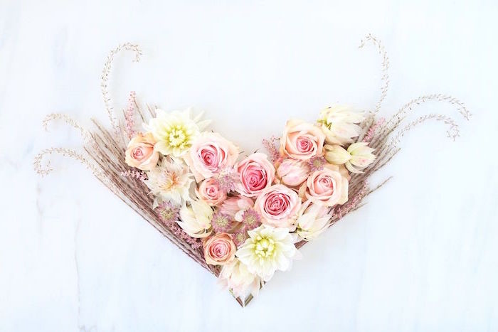 pink yellow roses peony flowers arranged in the shape of hearthappy valentines day pampass grass