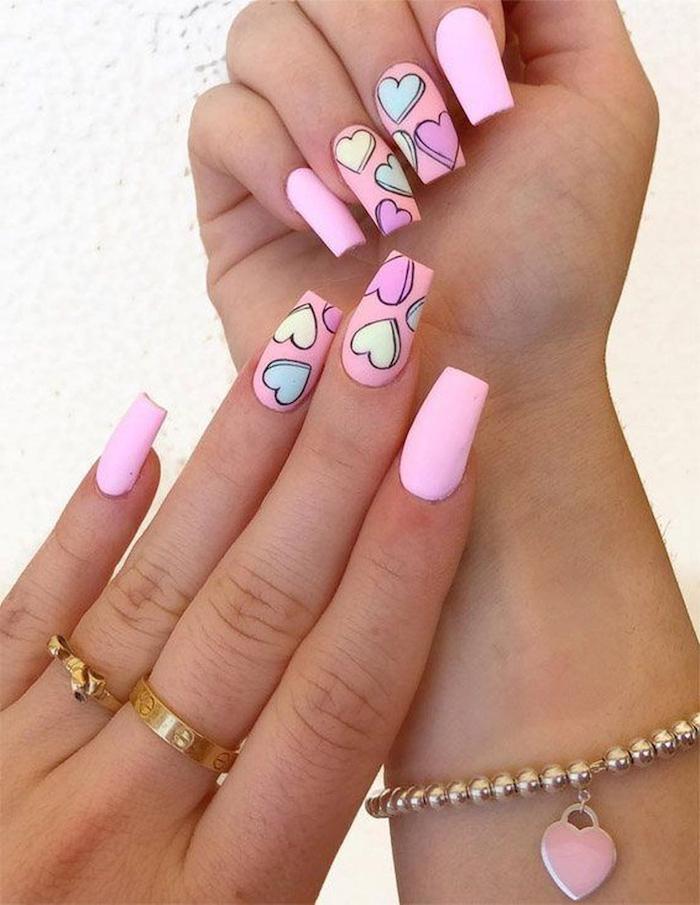 purple and pink matte nail polish cute nail designs hearts drawn on medium length coffin nails in purple green yellow