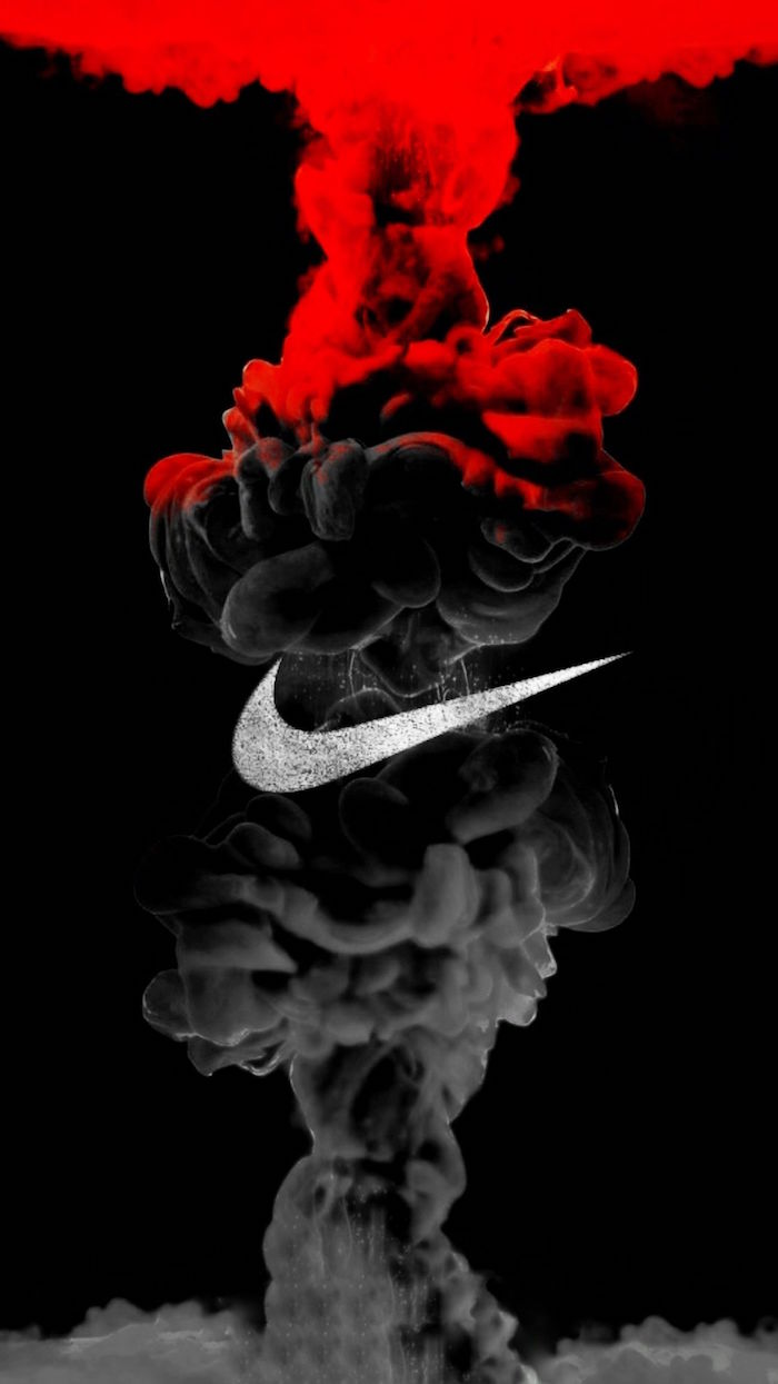 red and black digital drawing of smoke coming together on black background nike logo wallpaper silver glitter nike logo in the middle